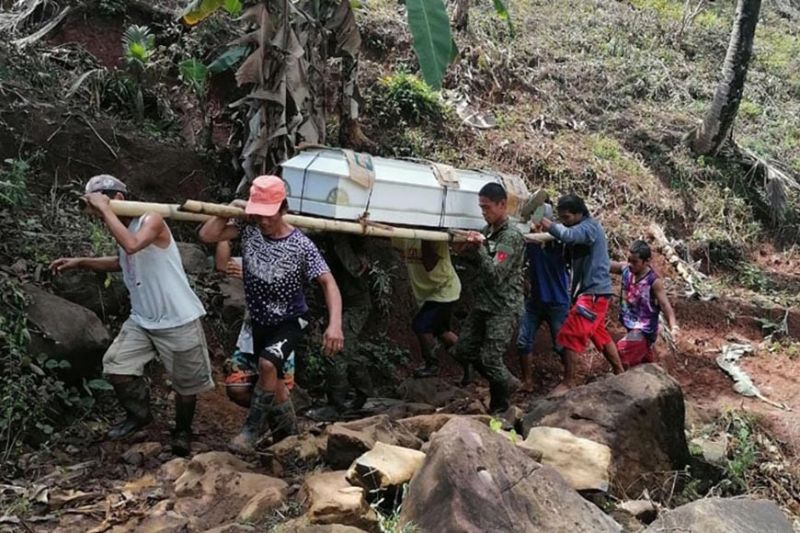 ZAMBOANGA. Government troops safely recover the remains of two slain New People's Army (NPA) rebels following a clash Thursday, April 22, in Guinlin, Tigbao, Zamboanga del Sur. A photo handout shows soldiers and relatives fetching the remains of one of the two slain NPA to his family in the hinterlands of Guipos municipality in the same province. (SunStar Zamboanga)