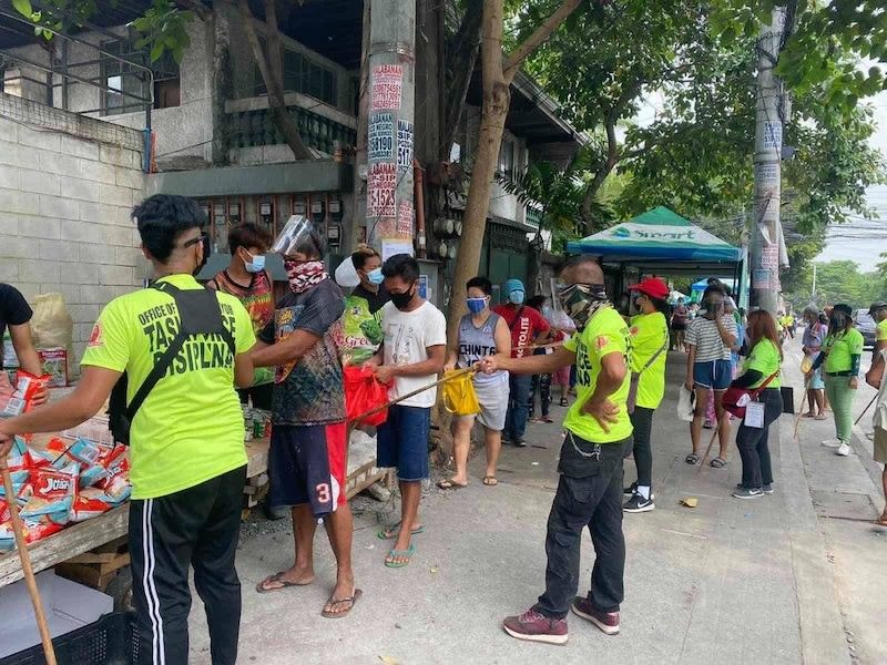 MANILA. In this photo taken on April 21, 2021, members of Quezon City Task Force Disiplina enforce physical distancing and other health protocols at the Maginhawa Community Pantry. (Third Anne Peralta-Malonzo)