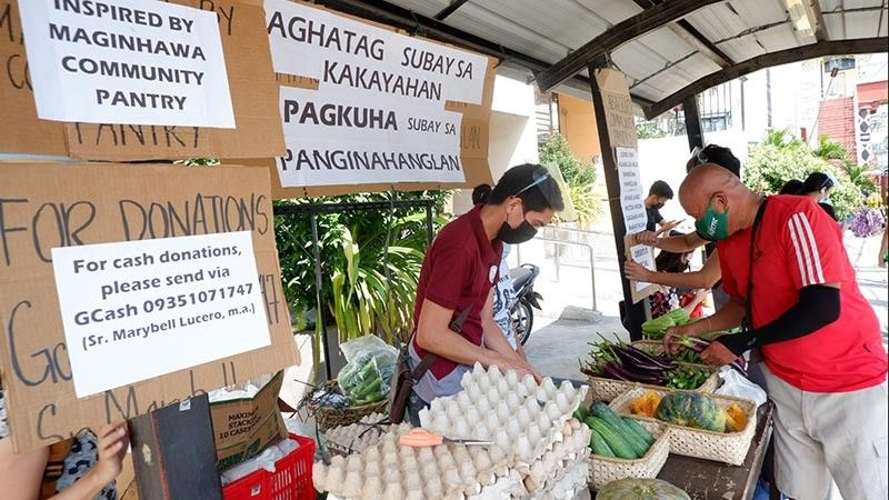 GENEROSITY.  Sr. Flora Secuya, coordinator of the community pantry organized by the Missionaries of the Assumption Convent in Cabaguio, shared that there was a boy who, after receiving a pack of rice from their community pantry, asked one of their Sisters if it is okay if he also donates the four sachets of coffee that he has. (Photo by Missionaries of the Assumption Convent)