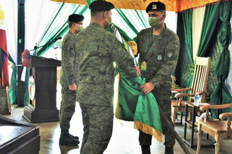 ZAMBOANGA. The Philippine Army installed last week a seasoned officer to lead the 5th Mechanized Infantry Battalion based in Maigo, Lanao del Norte. A photo handout shows Colonel Rey Alemania, 2nd Mechanized Infantry Brigade commander (right), hands over the command flag to Lieutenant Colonel Julius Librada, who was installed as the new battalion commander, replacing Colonel Alfonso Matias Jr. (SunStar Zamboanga)