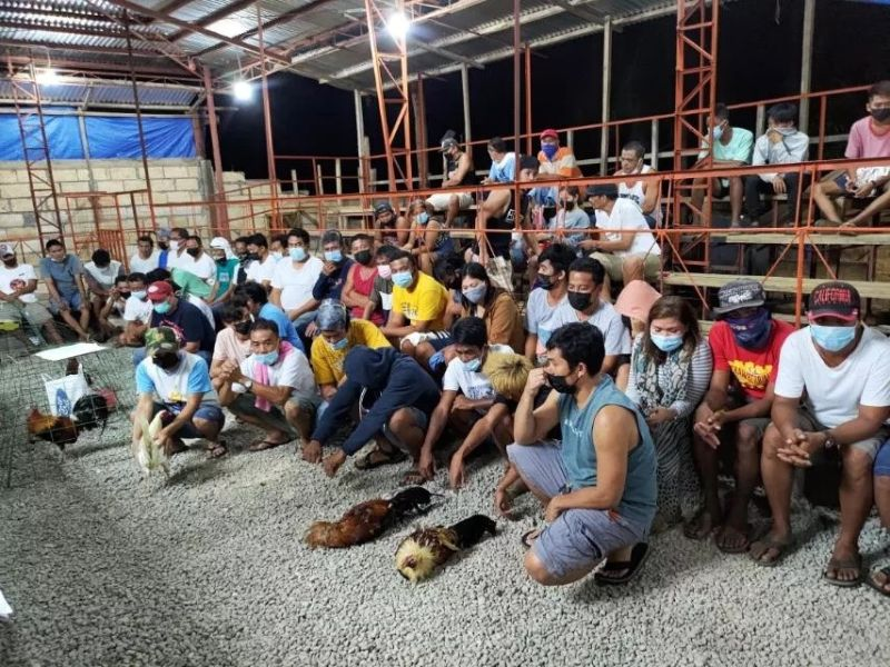 """ABRUPT ENDING. Fifty-five persons, including two municipal councilors, fail to complete their gambling revelry after they were caught by the police for participating in illegal cockfighting, locally known as """"tigbakay,"""" at Gallera de Laganason in Barangay Esperanza, Poro at 12:10 a.m. Monday, April 26, 2021. / PORO POLICE STATION"""