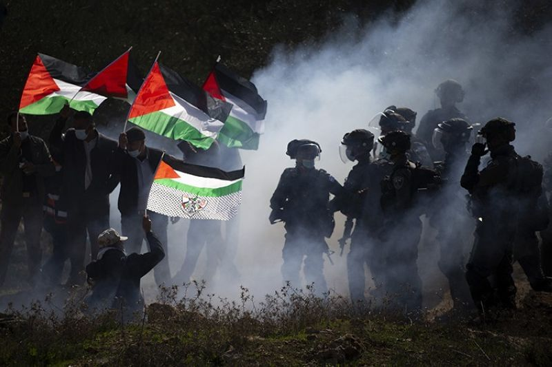 In this Dec. 3, 2020. file photo, Israeli border police officers and Palestinians clash during a protest against the expansion of Israeli Jewish settlements near the West Bank town of Salfit. One of the world's best-known human rights groups says Israel is guilty of the international crimes of apartheid and persecution. Human Rights Watch cites discriminatory policies toward Palestinians within Israel's own borders and in the occupied territories. In so doing, the New York-based group joins a growing number of commentators and rights groups that consider Israel and the territories as a single entity in which Palestinians are denied basic rights that are granted to Jews. (AP file photo)