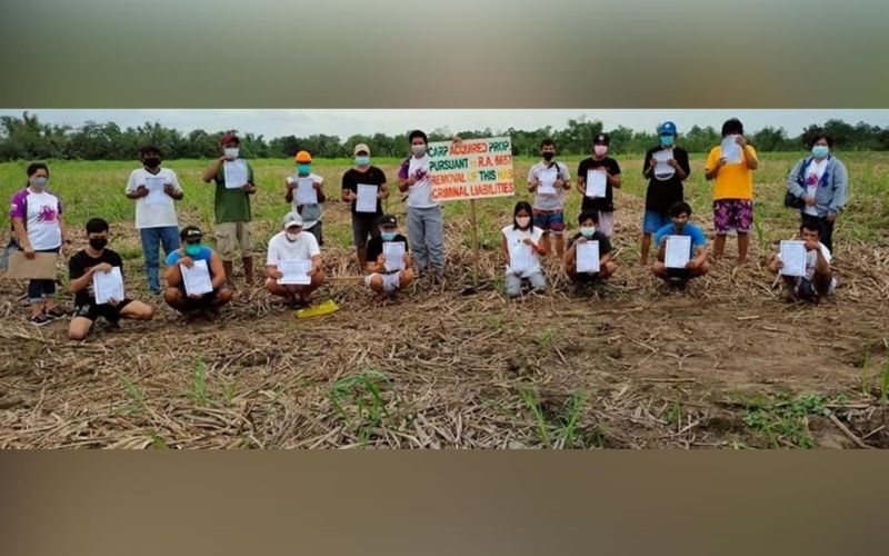 NEGROS. Sixteen agrarian reform beneficiaries in Talisay City receive their land titles from the Department of Agrarian Reform-Negros Occidental I in a distribution and installation rites recently. (Contributed Photo)