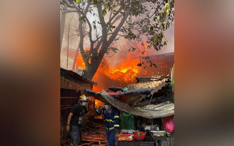 NO CASUALTIES. Fire razes 55 houses in Purok Neptune, Barangay Singcang-Airport, Bacolod City on Monday afternoon, April 26, 2021. (Contributed photo)