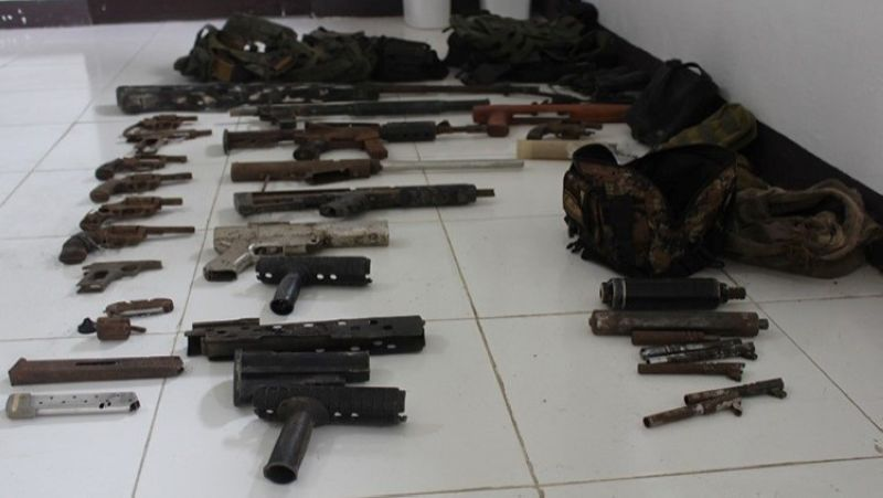 ZAMBOANGA. Military and police forces seize high-powered firearms and explosives in a law enforcement operation Tuesday, April 27, in Sitio Lasian in Kabuling village, Pandag, Maguindanao. A photo handout shows the weapons the troops recover during the law enforcement operation by way of service of search warrant. (SunStar Zamboanga)