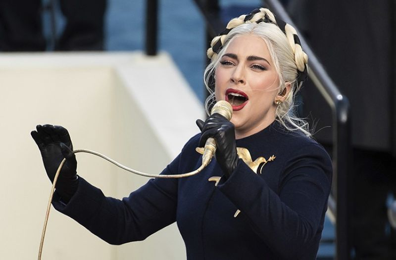 In this Jan. 20, 2021, Lady Gaga sings the national anthem during President-elect Joe Biden's inauguration at the U.S. Capitol in Washington. Los Angeles Police Department (LAPD) served several search and arrest warrants as a result of the investigation in the robbery of Lady Gaga's two stolen French bulldogs and shooting of her dog walker, Ryan Fischer, authorities announced Thursday, April 29, 2021, in Los Angeles. (AP file photo)