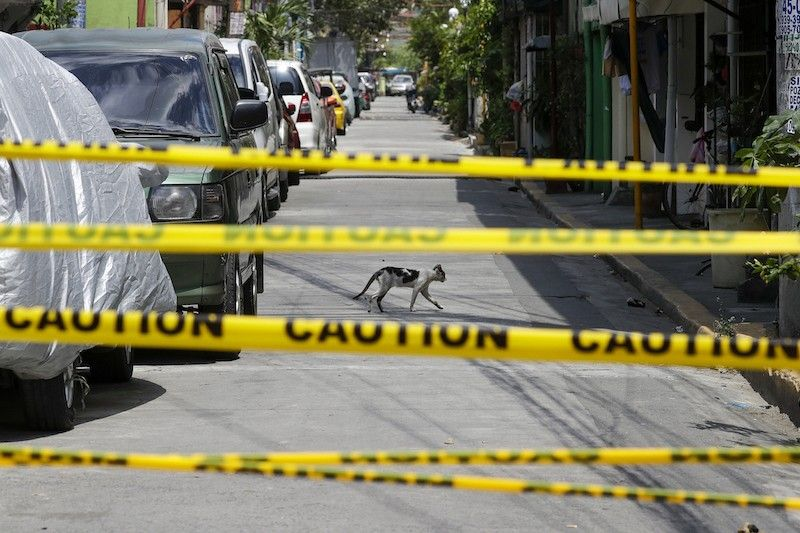 MANILA. A village in Metro Manila is under lockdown due to the number of Covid-19 cases among residents in Manila. (AP)