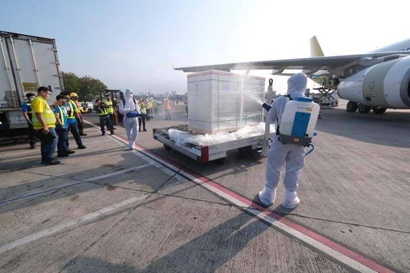 MORE VACCINES. Airport personnel disinfect the cargo containing 500,000 additional doses of Sinovac vaccine upon arrival at the NAIA on April 29, 2021. (Contributed photo)