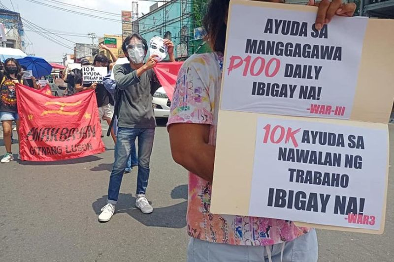 PAMPANGA. Members of the Workers' Alliance of Region 3 and Bayan Gitnang Luzon stage a rally on Miranda Street, Angeles City in observance of Labor Day on May 1, 2021. (WAR III photo)