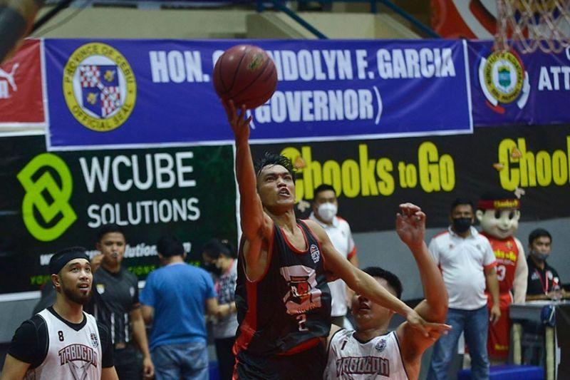 Dumaguete's Jaybie Mantilla scores on a layup in overtime of their thrilling game versus Tabogon. / Chooks-to-Go