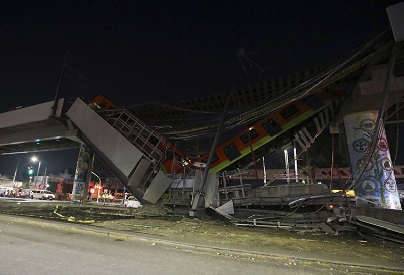 MEXICO CITY. Mexico City's subway cars lay at an angle after a section of Line 12 of the subway collapsed in Mexico City, Tuesday, May 4, 2021. The section passing over a road in southern Mexico City collapsed Monday night, dropping a subway train, trapping cars and causing at least 50 injuries, authorities said. (AP Photo)
