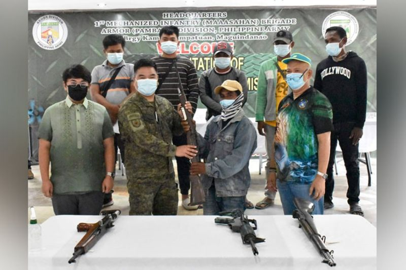 ZAMBOANGA. Six members of the Bangsamoro Islamic Freedom Fighters (BIFF) surrender Tuesday, May 4, due to the continued military offensive against them in Maguindanao. A photo handout shows one of the surrenderers hands over a rifle to Colonel Pedro Balisi Jr., 1st Mechanized Infantry Brigade commander. (SunStar Zamboanga)