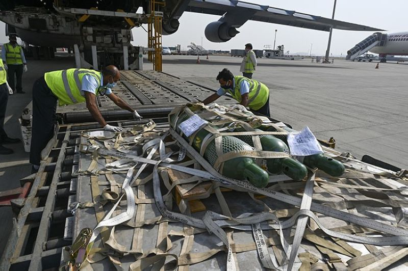 In this April 30, 2021, file photo, relief supplies from the United States in the wake of India's Covid-19 situation arrive at the Indira Gandhi International Airport cargo terminal in New Delhi, India. India's large diaspora is tapping its wealth, growing political clout and expertise to help India combat a catastrophic coronavirus surge that has led to desperate pleas for oxygen and left people to die outside overwhelmed hospitals. (AP file photo)