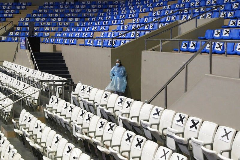 MANILA. A health worker stands beside seats with markers at a vaccination center inside the Makati Coliseum in Metro Manila on Tuesday, May 4, 2021. The Philippines held a dry run of Sputnik V inoculations with the initial 15,000 doses that arrived on May 1. (AP)
