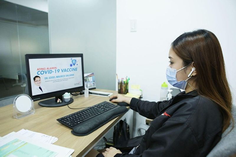 WEBINAR. A LausGroup of Companies employee attends the company webinar on the importance of the Covid-19 vaccination led by Dr. Edsel Salvana. (Contributed photo)