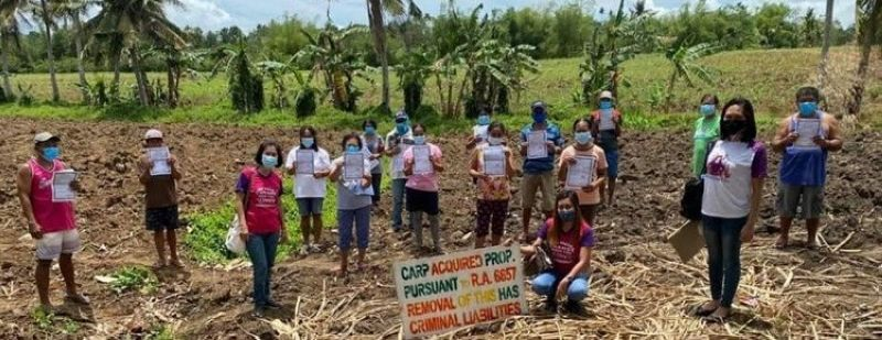 CADIZ. Some of the 49 agrarian reform beneficiaries who were installed to over 33-hectare land in Cadiz City on Tuesday. (Contributed photo)