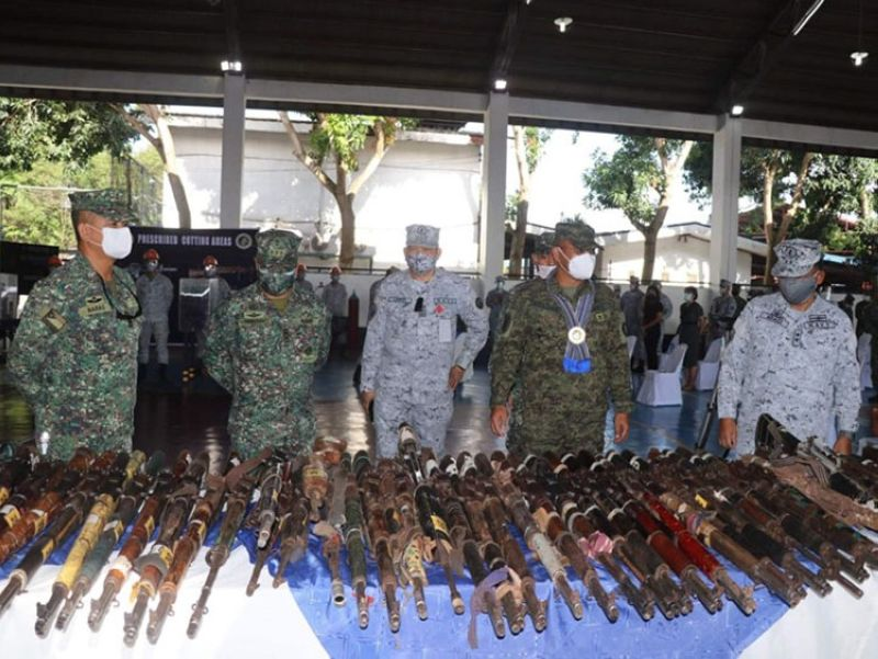 ZAMBOANGA. The Naval Forces Western Mindanao (NFWM) destroys Friday, May 7, 219 assorted firearms, majority of which were seized in the campaign against terrorist and lawless groups in Central Mindanao, Sulu, and Tawi-Tawi. A photo handout shows Rear Admiral Toribio Adaci Jr., NFWM commander (right), and Lieutenant General Corleto Vinluan Jr., Western Mindanao Command (Westmincom) chief, and other military officials inspect the firearms before the destruction at Naval Station Romulo Espaldon. (SunStar Zamboanga)