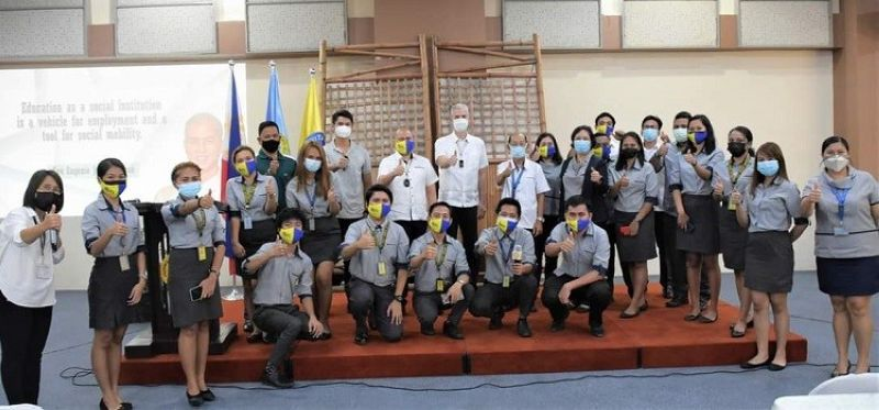 NEGROS OCCIDENTAL. Officials led by Governor Eugenio Jose Lacson with the province's ICT scholars during the presentation of the applications they developed to be adopted by the provincial government. (Contributed photo)