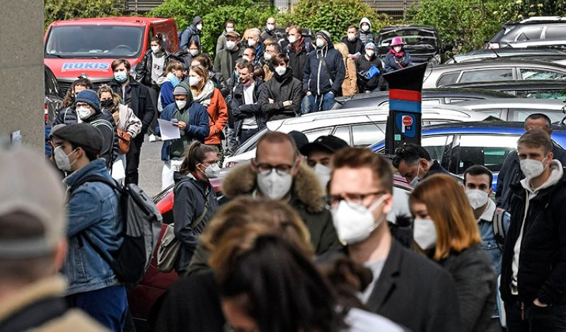 GERMANY. Several hundreds of people line up to receive an AstraZeneca vaccination against the coronavirus at the forum of the DITIB central mosque in Cologne, Germany, Saturday, May 8, 2021. (AP)