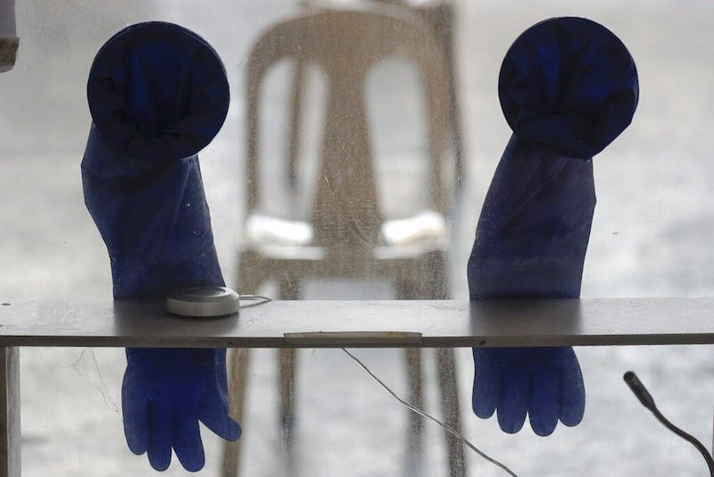 MANILA. Rubber gloves hang on a cubicle used at a Covid-19 testing site to curb the spread of the coronavirus in Quezon City on April 29, 2021. (AP)