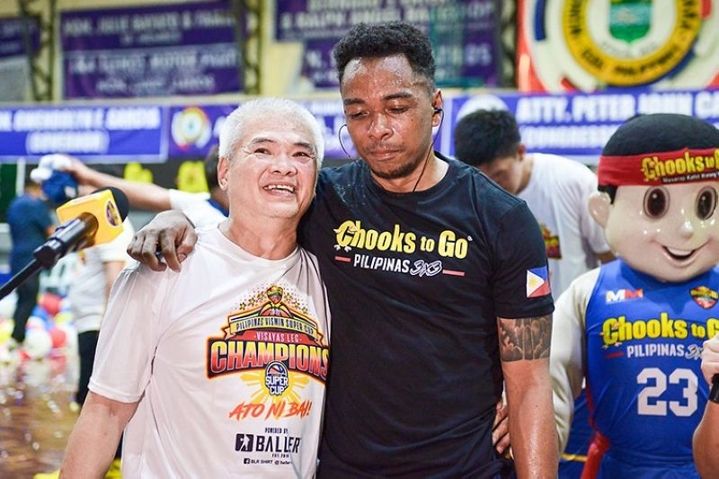 TNT head coach Chot Reyes said he is very happy and proud of the success his younger brother, Mike (in image with Ping Exciminiano), has had in Cebu, especially of his recent title win in the VisMin Cup. (VisMin Cup) )