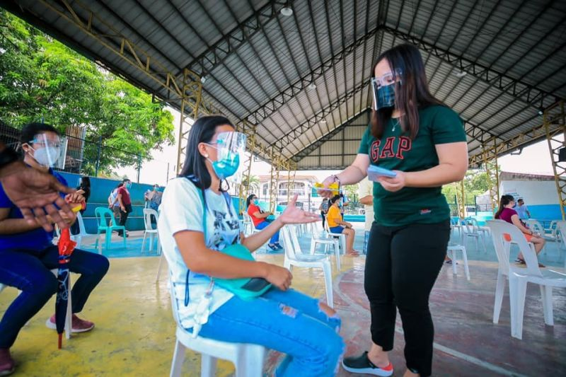 ASSISTANCE FOR YOUNG PWDs. On behalf of a young PWD from San Fernando, a parent received the educational assistance program of the Provincial Government of Pampanga. (City of San Fernando Information Office)