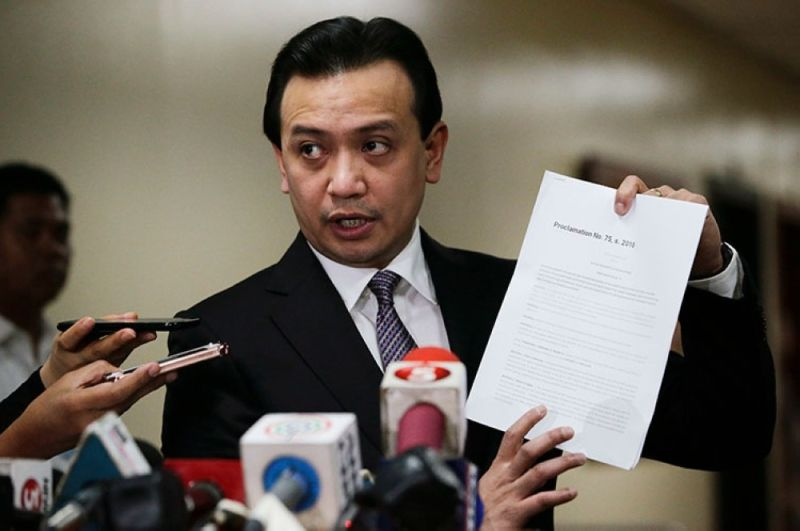 MANILA. In this file photo, opposition senator Antonio Trillanes IV shows to reporters a copy of his amnesty documents outside his office where he remains holed up in the Philippine Senate in Pasay City on September 11, 2018. (AP)