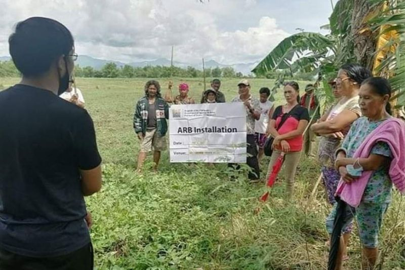 NEGROS. Municipal Agrarian Reform Program Officer Drexel Glen Pajarilla discusses the rights and obligations of agrarian reform beneficiaries during the installation rites in Barangay Candumarao, Hinigaran town on Tuesday, May 11, 2021. (Contributed photo)