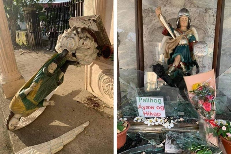 ANGELS NOT SPARED. Residents awake to the sight of the statue of St. Raphael the Archangel on the ground with a broken wing, and the statue of St. Michael the Archangel shorn of its glass enclosure outside the Archdiocesan Shrine and Parish of St. Michael the Archangel in Argao town in southern Cebu Wednesday, May 12, 2021. The vandal swung with no fear or respect for the sign not to touch the glass. (ARGAO POLICE)