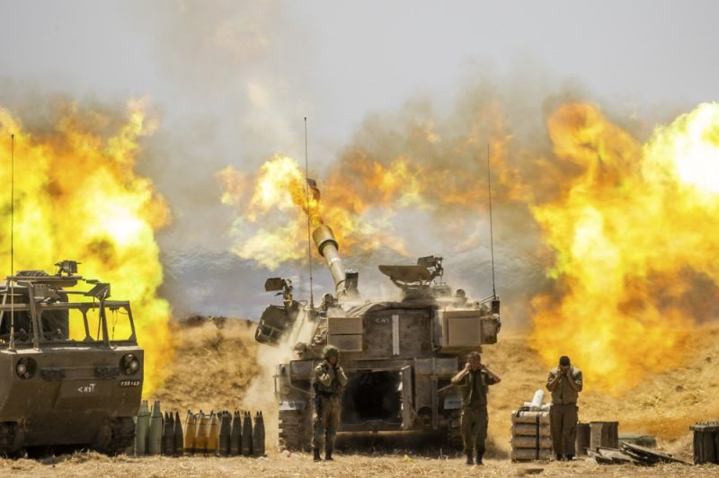 An Israeli artillery unit fires toward targets in Gaza Strip, at the Israeli Gaza border, Wednesday, May 12, 2021. (AP Photo/Yonatan Sindel)