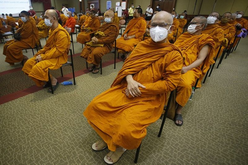 Buddhist monks wait to receive Sinovac Covid-19 vaccines at Priest hospital in Bangkok, Thailand Tuesday, May 18 , 2021. Thailand had about 7,100 cases, including 63 deaths, in all of last year, in what was regarded as a success story. Taxi drivers are starved for customers, weddings are suddenly canceled, schools are closed, and restaurant service is restricted across much of Asia as the coronavirus makes a resurgence in countries where it had seemed to be well under control. (AP Photo)