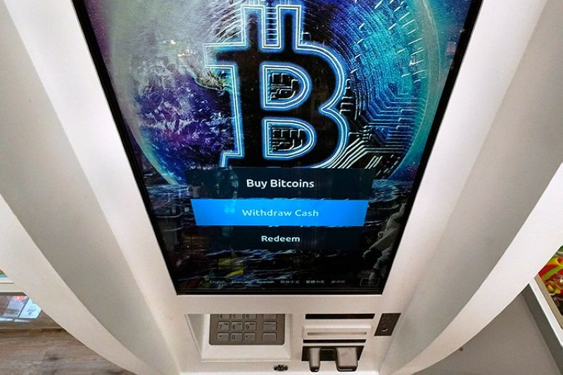 USA. In this February 9, 2021 file photo, the Bitcoin logo appears on the display screen of a crypto currency ATM at the Smoker's Choice store in Salem, N.H. (AP)
