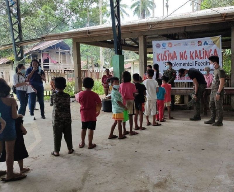 ZAMBOANGA. The Army's 97th Infantry Battalion, through its Civil-Military Operations team, holds a feeding program that benefitted 300 persons in Seres village, Katipunan, Zamboanga del Norte. A photo handout shows children, who were served with chicken and pork and beans, lining up to receive their share of food. (SunStar Zamboanga)