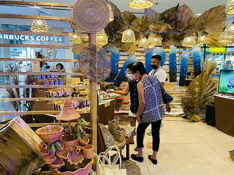 EXHIBIT. Shoppers visit Barili's booth at the opening of the fifth R'Cebu Exhibit which features tourism spots and local products of the third district of Cebu at the Robinsons Galleria Cebu. The exhibit runs from May 21 to 23, 2021. / KATLENE O. CACHO