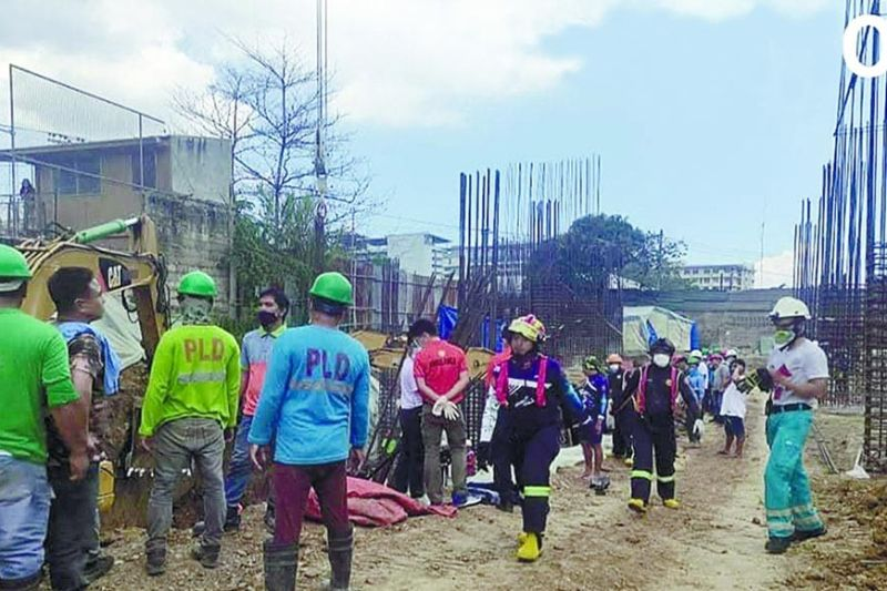 FATAL MORNING ACCIDENT. A collapse at a construction site on Lapulapu St. in Barangay Apas, Cebu City Saturday morning, May 22, 2021, results in the death of one worker and the injury of another. / CDRRMO