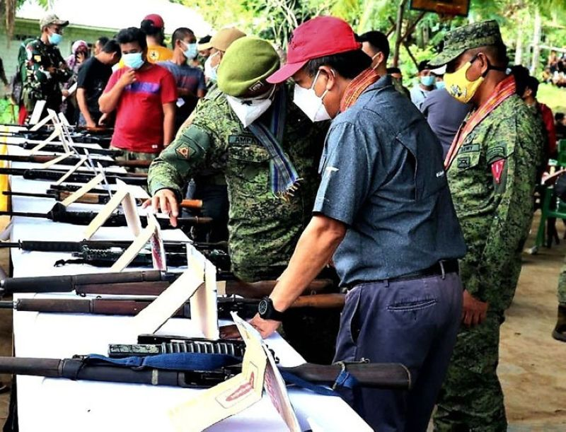 ZAMBOANGA. Military and provincial government officials of Basilan have entered into a Memorandum of Understanding (MOU) Friday, May 21, that seeks to intensify the implementation of the small arms and light weapons (SALW) program in the province. A photo handout shows Lieutenant Colonel Alex Ampati, 4th Special Forces Battalion commander (left), inspecting some surrendered firearms. (Contributed photo)