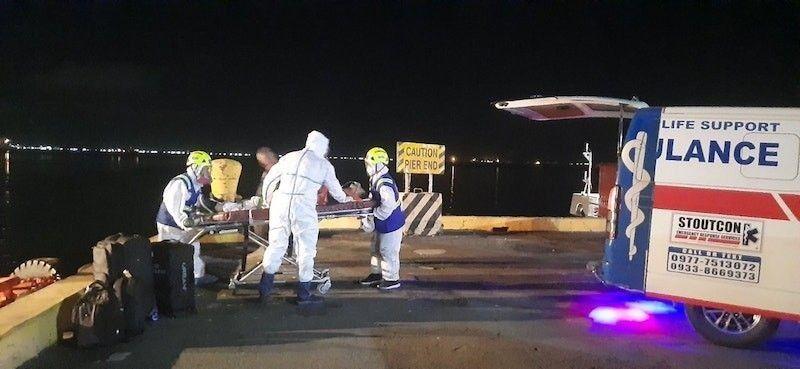 MANILA. A medevac team transfers four crew members of MV Athens Bridge to a hospital in Metro Manila on May 6, 2021. (Maritime Industry Authority)