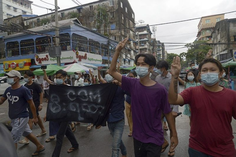 Anti-coup protesters flash the three-finger salute during a demonstration against the military takeover, in Yangon, Myanmar, Monday, May 24, 2021. (AP Photo)