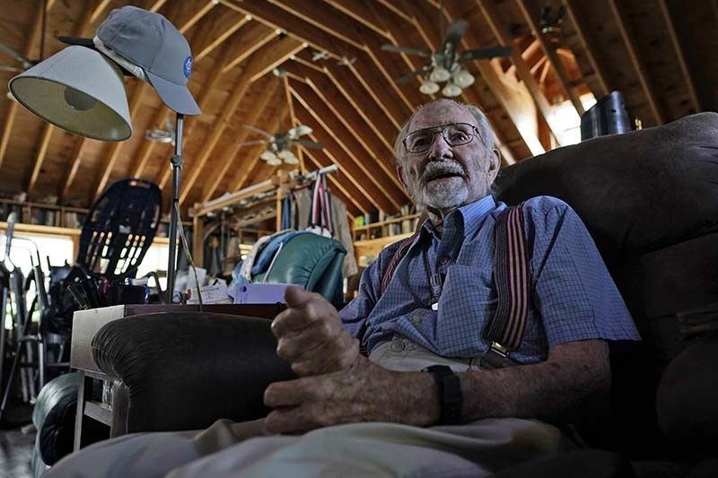 Former WWII bomber pilot and commercial airline pilot, John Billings, talks to a reporter at his home in Woodstock, Va., Wednesday, May 5, 2021. Billings, 97, was a World War II pilot with members of the OSS Society. He continues to fly, working as a volunteer to transport patients in need to specialized medical centers through a program called Angel Flight. (AP Photo/Steve Helber)
