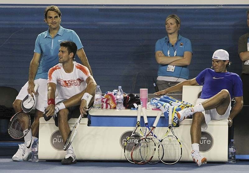 POWER TRIO. Roger Federer of Switzerland, left, Novak Djokovic of Serbia, seated, left, and Rafael Nadal of Spain watch an exhibition tennis match in Melbourne, Australia, in this Sunday Jan. 17, 2010, file photo. Djokovic, Nadal and Federer all ended up in the same half of the French Open men's field in the draw Thursday, May 27, 2021, meaning no more than one of them can reach the final. / AP