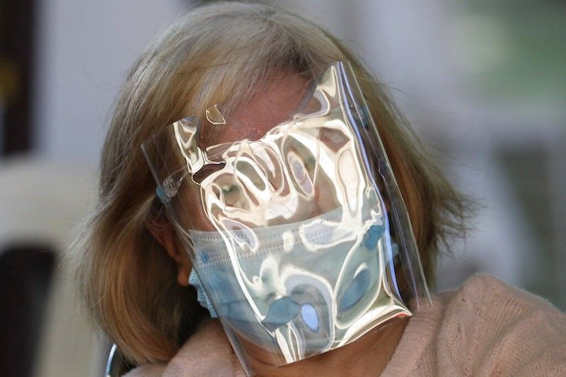 MANILA. An elderly woman wearing a face shield and protective mask to prevent the spread of the coronavirus waits after being inoculated with the Sinovac Covid-19 vaccine in Quezon City in this photo taken on May 14, 2021. (File)