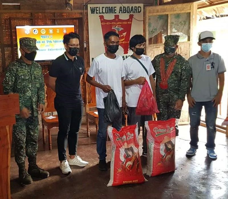 ZAMBOANGA. Two Abu Sayyaf bandits (in white shirts) involved in the kidnapping of foreigners years ago surrendered Tuesday, June 1, to the Marine Battalion Landing Team-7 in Sulu. A photo handout shows the two surrenderers receive food packs as initial assistance given to them by the government. (SunStar Zamboanga)