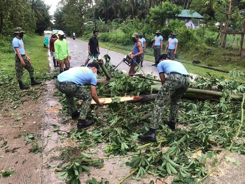 BILIRAN. Search and rescue team of Kawayan Municipal Police Station, headed by Lieutenant Junriel Rosario, leads the road clearing operation in Kawayan, Biliran after Tropical Storm Dante dumped intense rain that triggered floods in Eastern Visayas towns on June 1, 2021. (Photo from Kawayan MPS)