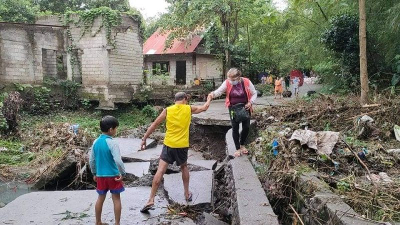 BACOLOD. A road approaching the overflow at Barangay Vista Alegre in Bacolod City was destroyed following a heavy downpour early morning, Wednesday. (Adrian Prietos photo)
