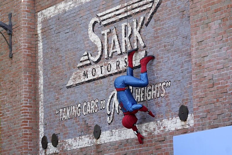 A Spider-Man character performs during