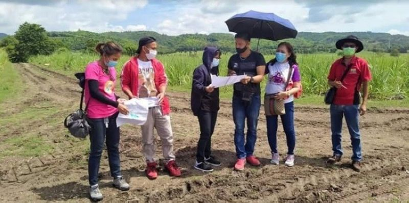 NEGROS. The survey team from the Department of Agrarian Reform in Negros Occidental-North conducts a survey validation in a 77.9545-hectare landholding in Barangay Refugio in Calatrava town Friday, June 4, 2021. (Contributed photo)