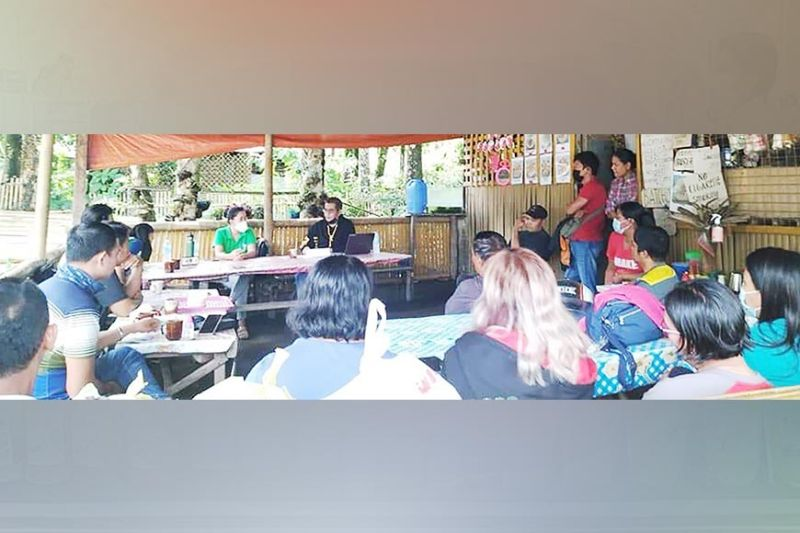 TALISAY. Members of Group of Environmental Socialists (Goes) underscores the issue of alleged illegal road clearing activity in Talisay City in a meeting with the Department of Environment and Natural Resources and affected community during the celebration of World Environment Day over the weekend. (Contributed photo)