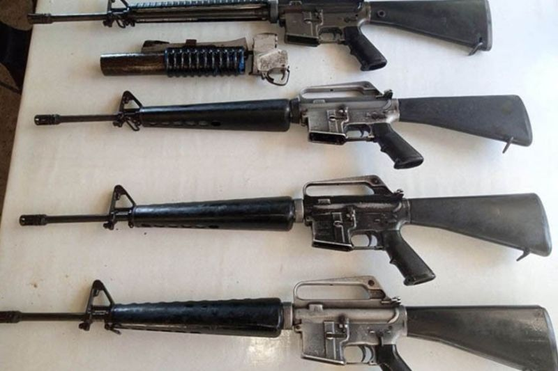 ZAMBOANGA. Five New People's Army (NPA) rebels who surrendered on May 12 and 29 in the province of Zamboanga del Sur yield eight high-powered firearms Sunday, June 6, to the 53rd Infantry Battalion when two other rebels surrender on the same day. A photo handout shows four of the rifles they yield to the government troops. (SunStar Zamboanga)