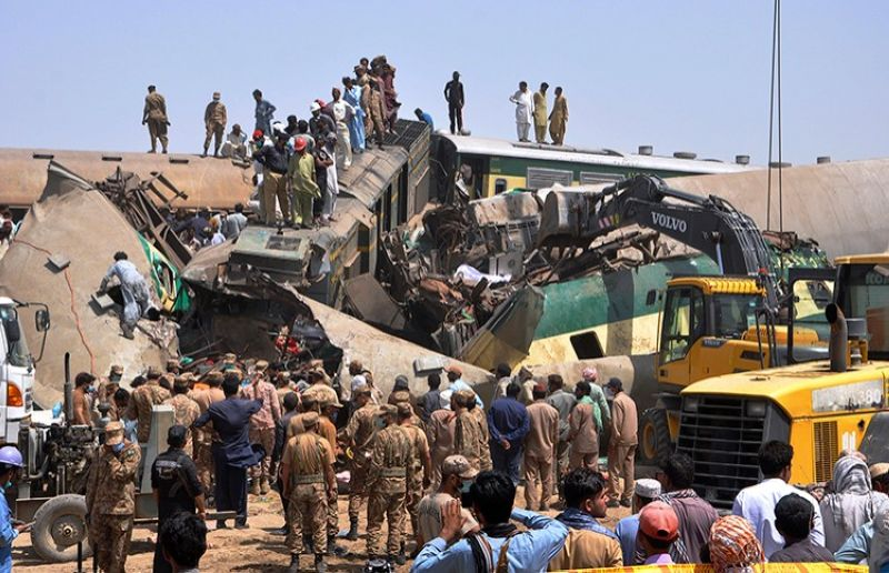PAKISTAN. Soldiers and volunteers work at the site of a train collision in the Ghotki district in southern Pakistan, Monday, June 7, 2021. (AP)