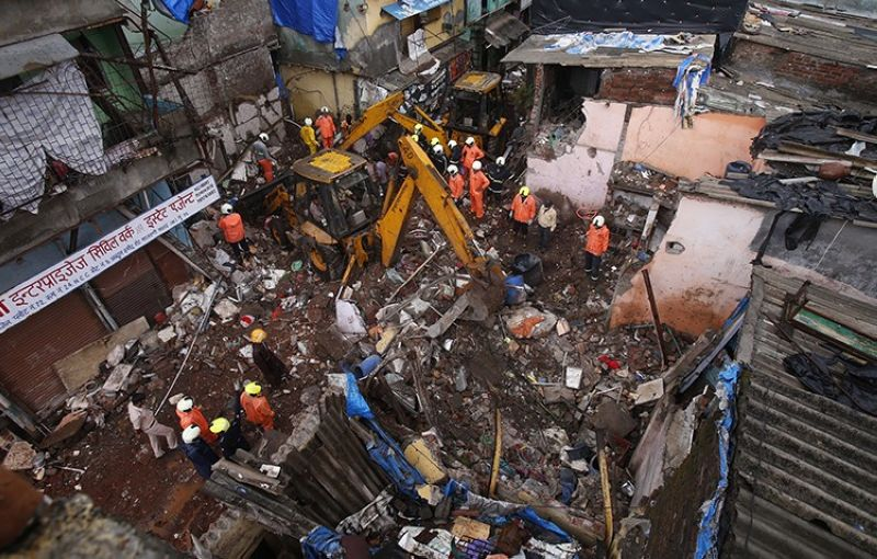 Rescuers clear the debris to find any residents possibly still trapped after a three-story dilapidated building collapsed following heavy monsoon rains n Mumbai, India, Thursday, June 10, 2021. (AP Photo)